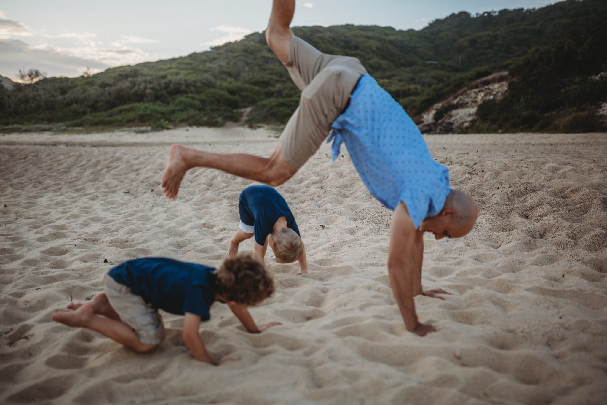 Newcastle family photographer; father and sons playing