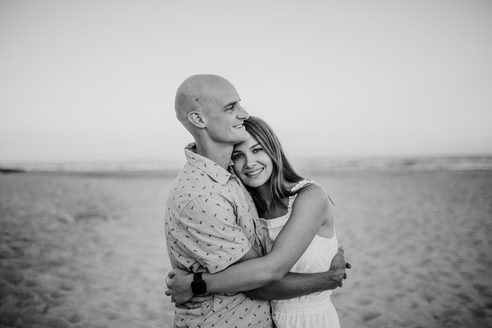 Newcastle family photographer; husband and wife hugging