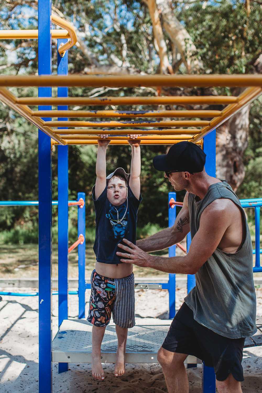 Newcastle family photographer beach summer holiday kids fun at playground
