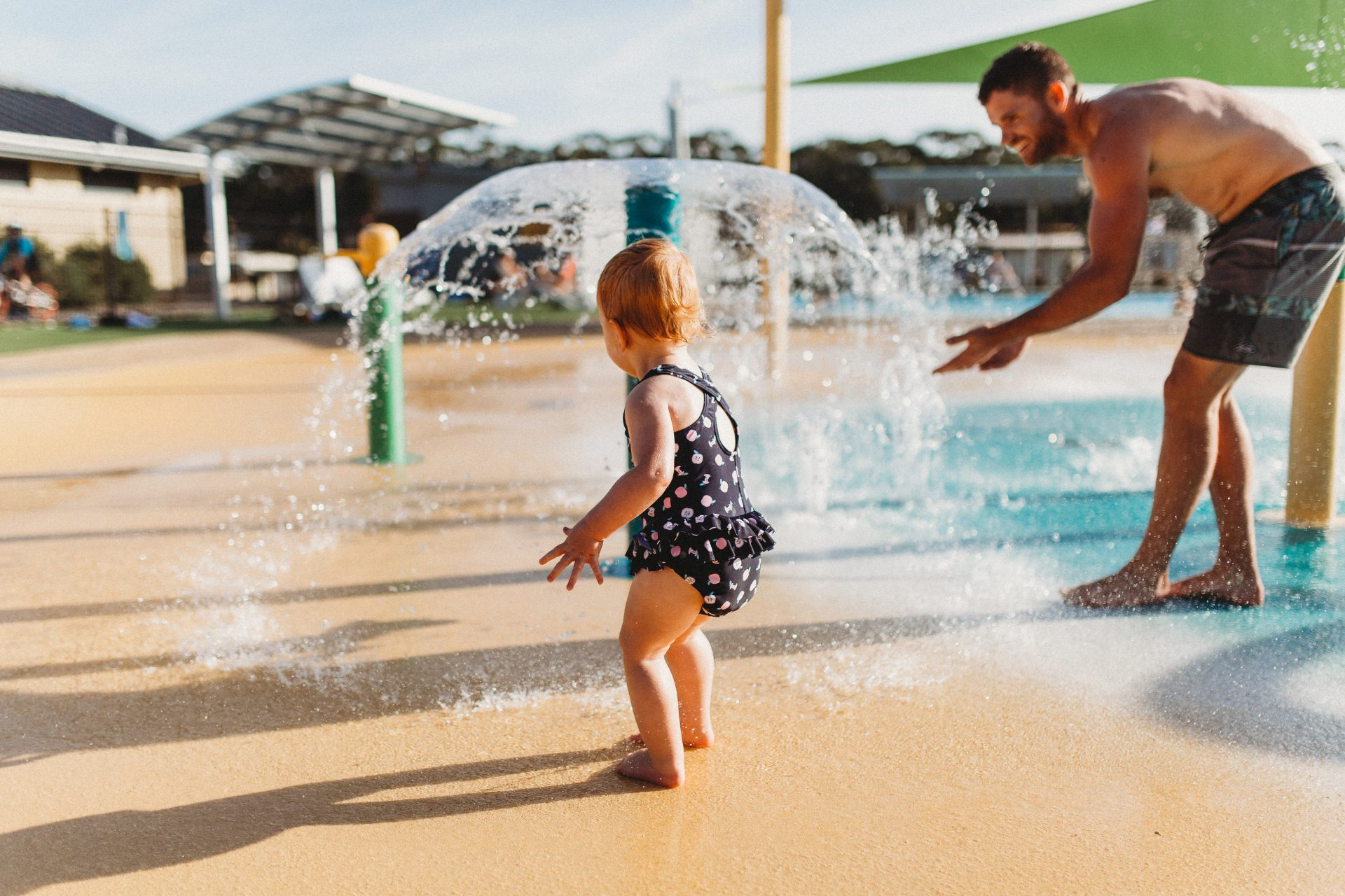 Little girl playing at a water park