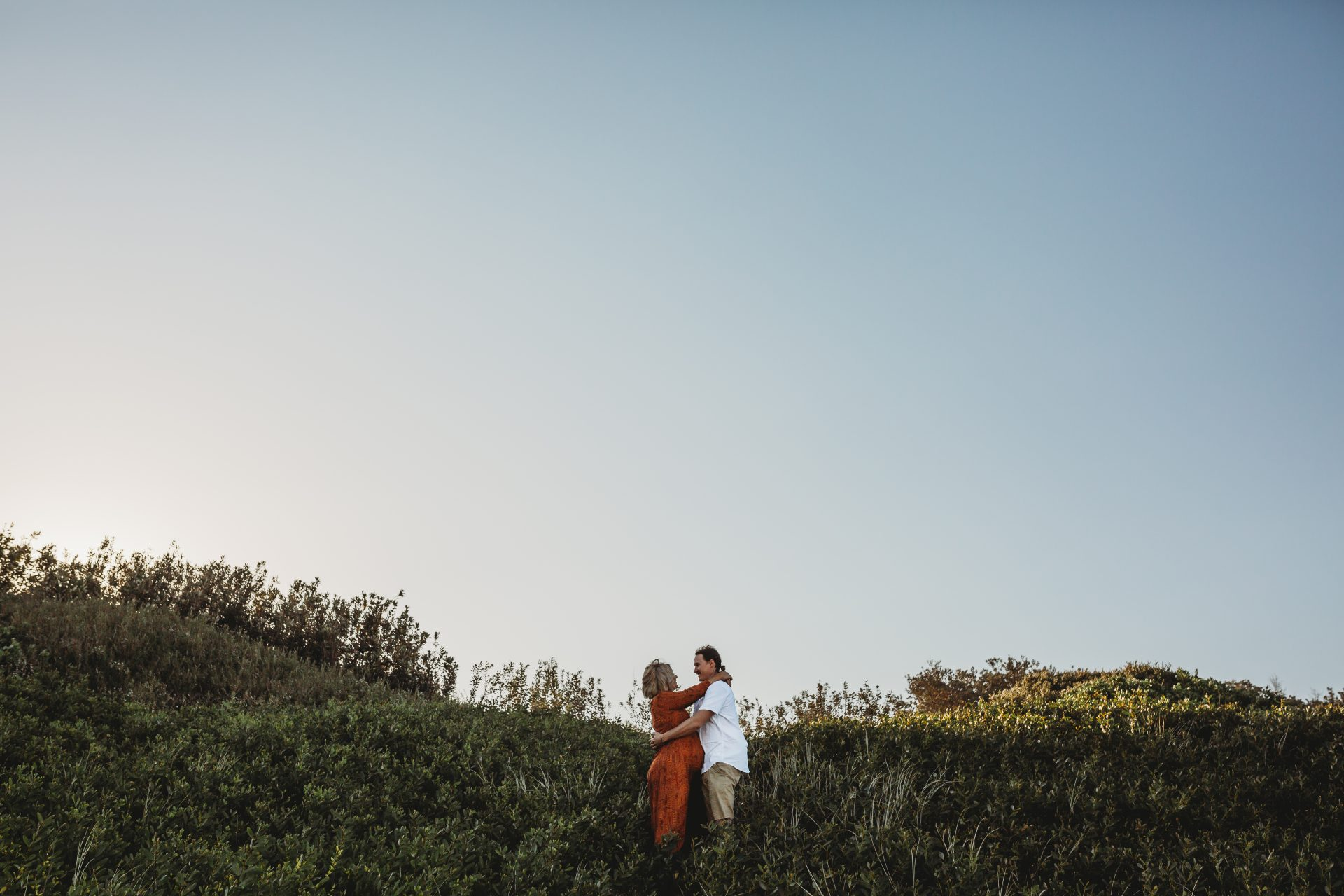 Couple hugging in beach landscape