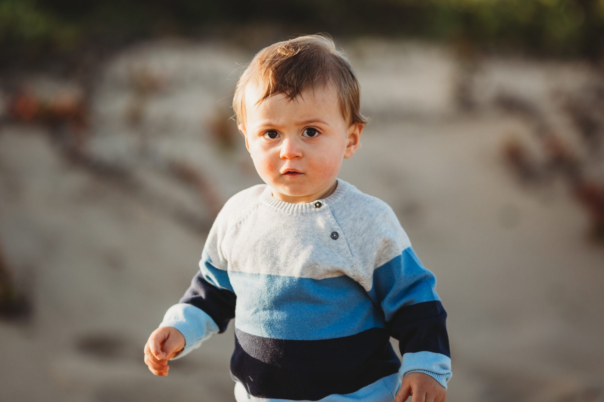 Portrait of toddler boy at the beach