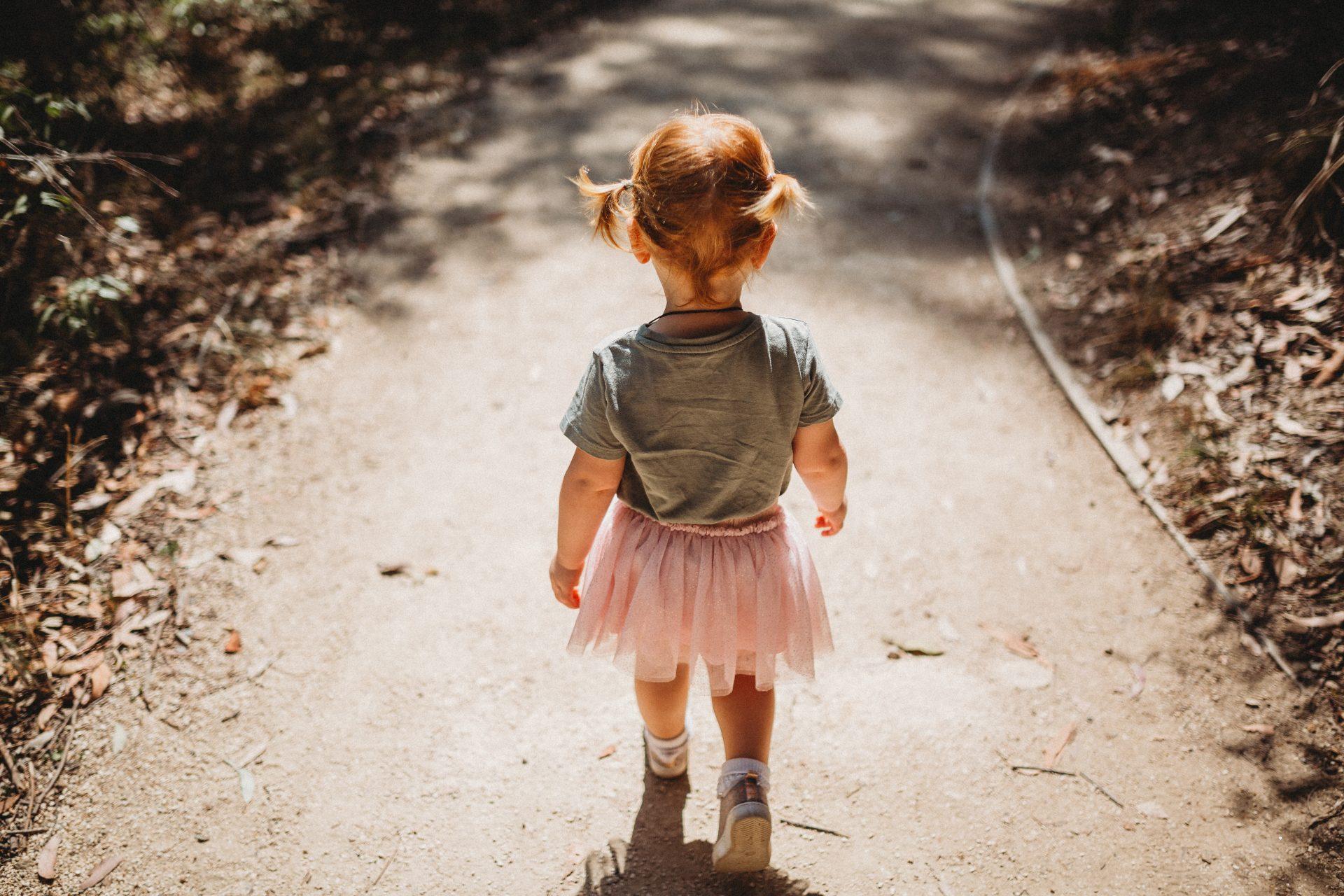 Girl toddler bushwalking in tutu
